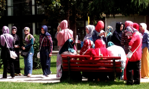 Muslim women gathering outside of a school in Albania.